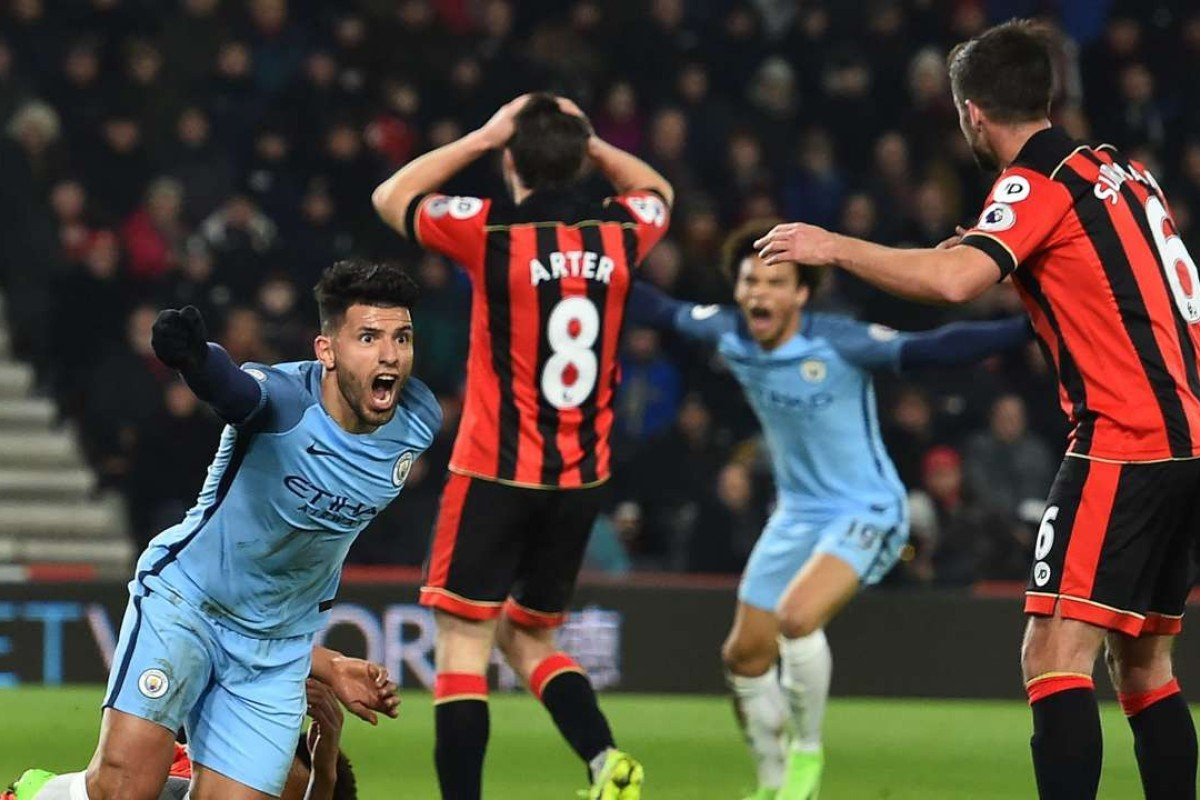 98518c3bf67 Manchester City s Sergio Aguero celebrates after scoring the second goal in  the win over Bournemouth.