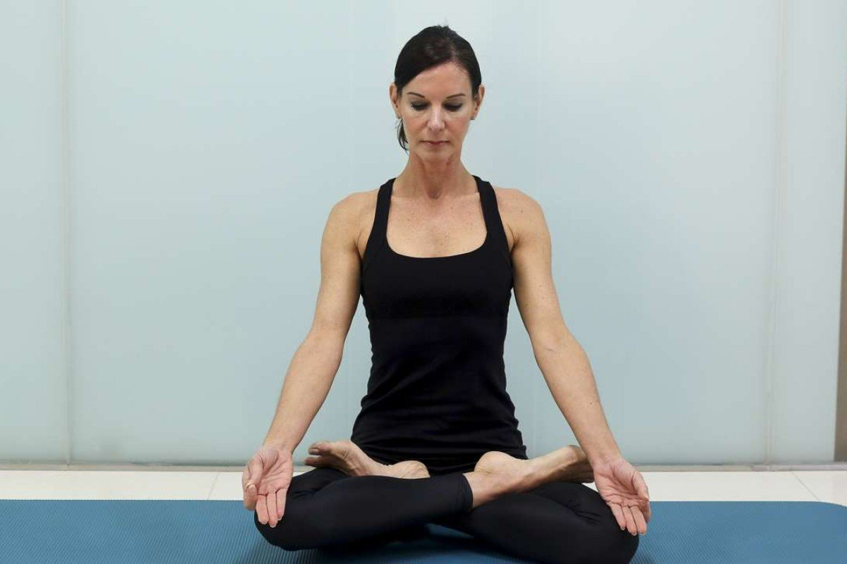 Heather Thomas Shalabi, managing director of Flex Studio in Wong Chuk Hang, performs kapalbhati breathing exercises. Photos: May Tse