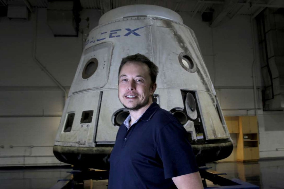 SpaceX announces it will fly two people around the moon next