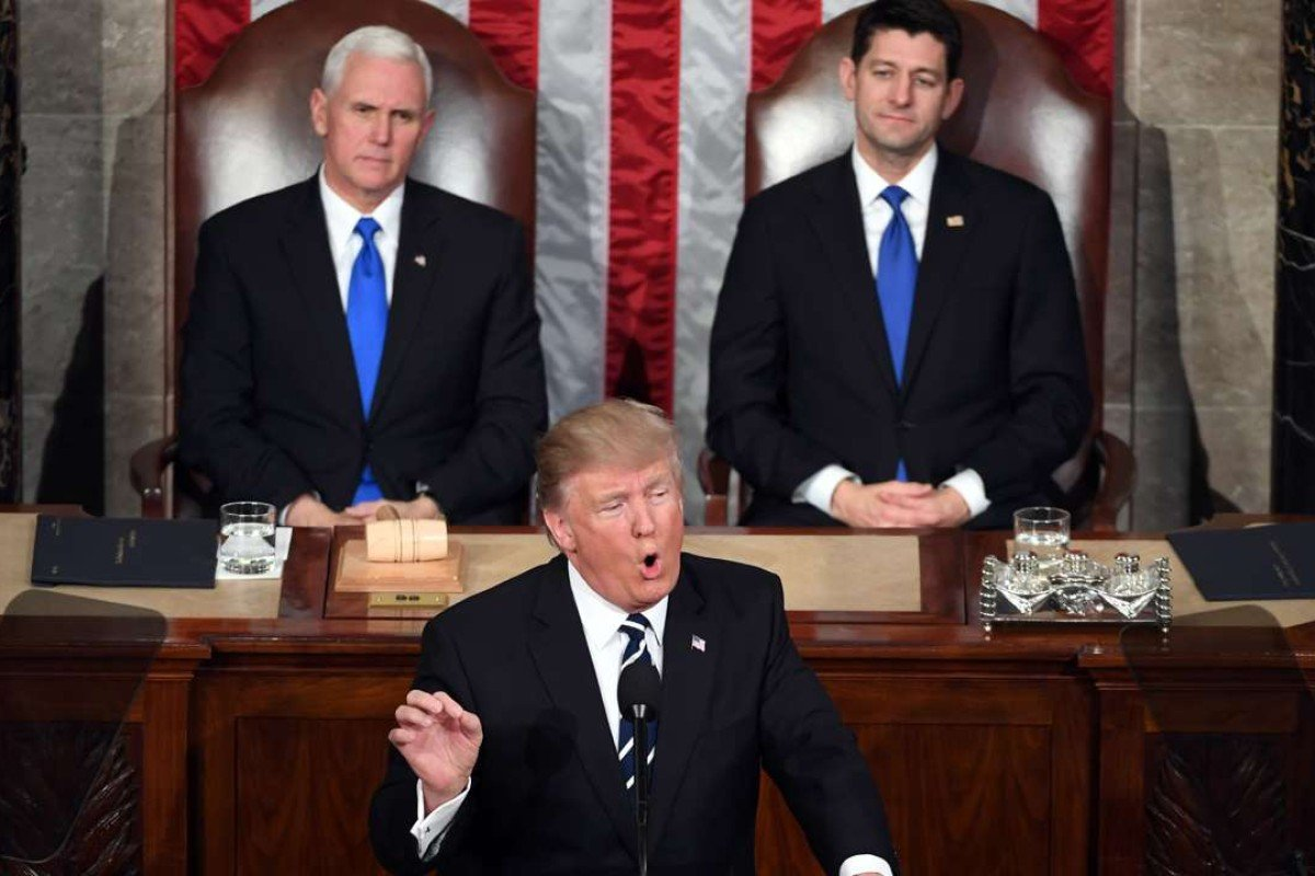 053f88cdc US President Donald Trump addresses a joint session of Congress, as  Vice-President Mike
