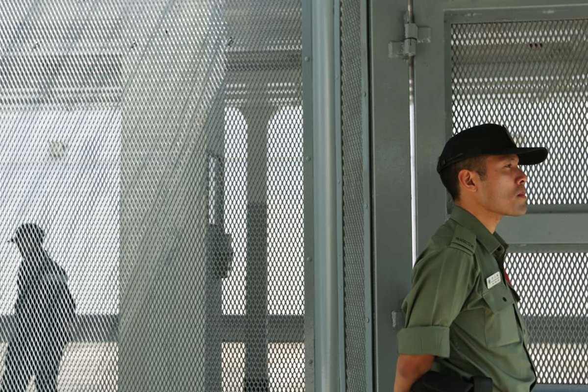 A guard stands watch at Stanley Prison. Photo: Xiaomei Chen