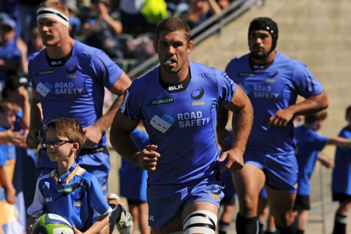 ed7214cc94a Western Force captain Matt Hodgson (centre) leads his team out against  South Africa's Southern