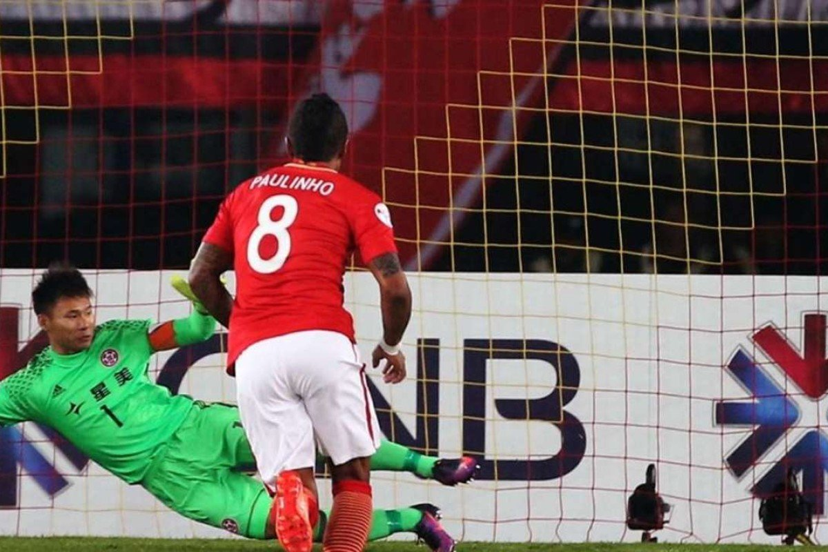 41a316cb8 Evergrande s Paulinho scoring against Eastern goalkeeper Yapp-Hung-fai.  Photo  K. Y. Cheng