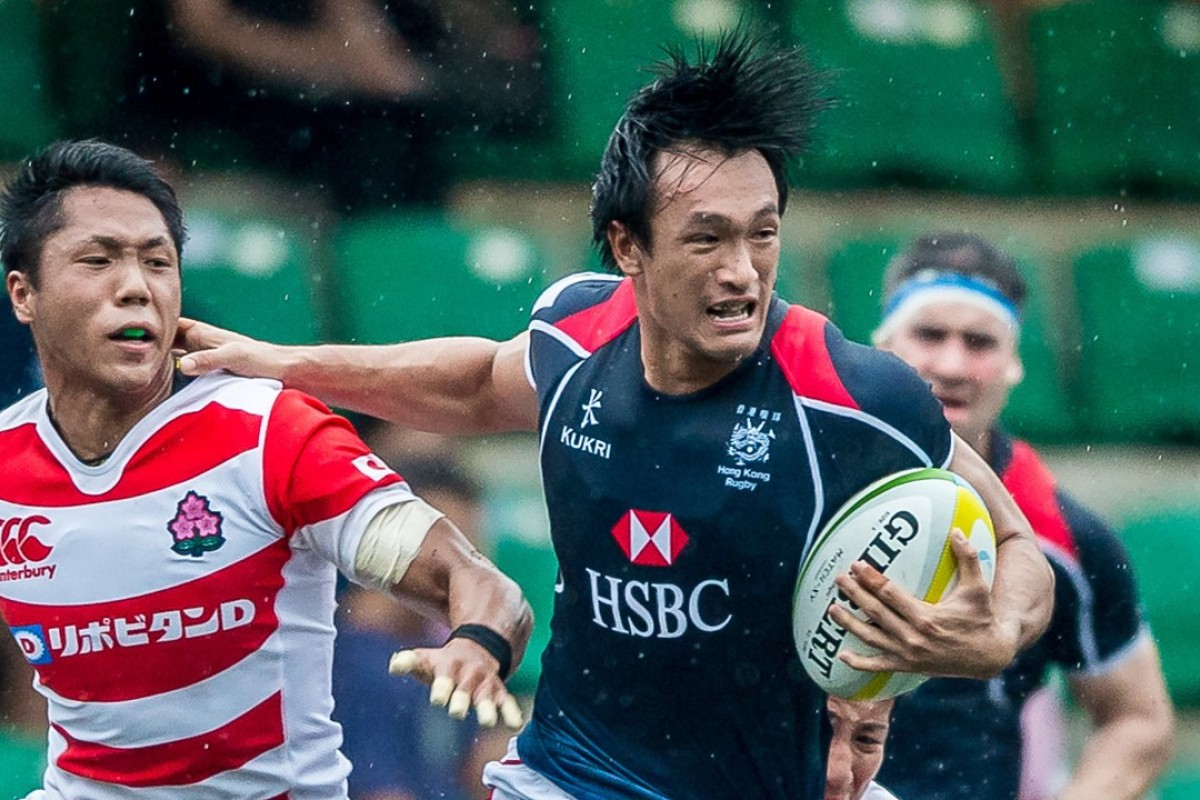 e1383075320 Salom Yiu carries for Hong Kong against Japan in the Asia Rugby  Championship. Photo