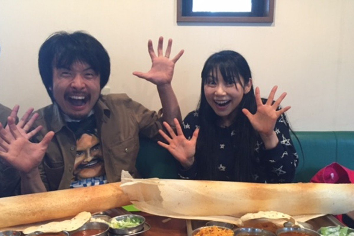 ba6ac36e6c3 Hiroyoshi Takeda and Mikan are excited about their dosas in a restaurant in  eastern Tokyo.