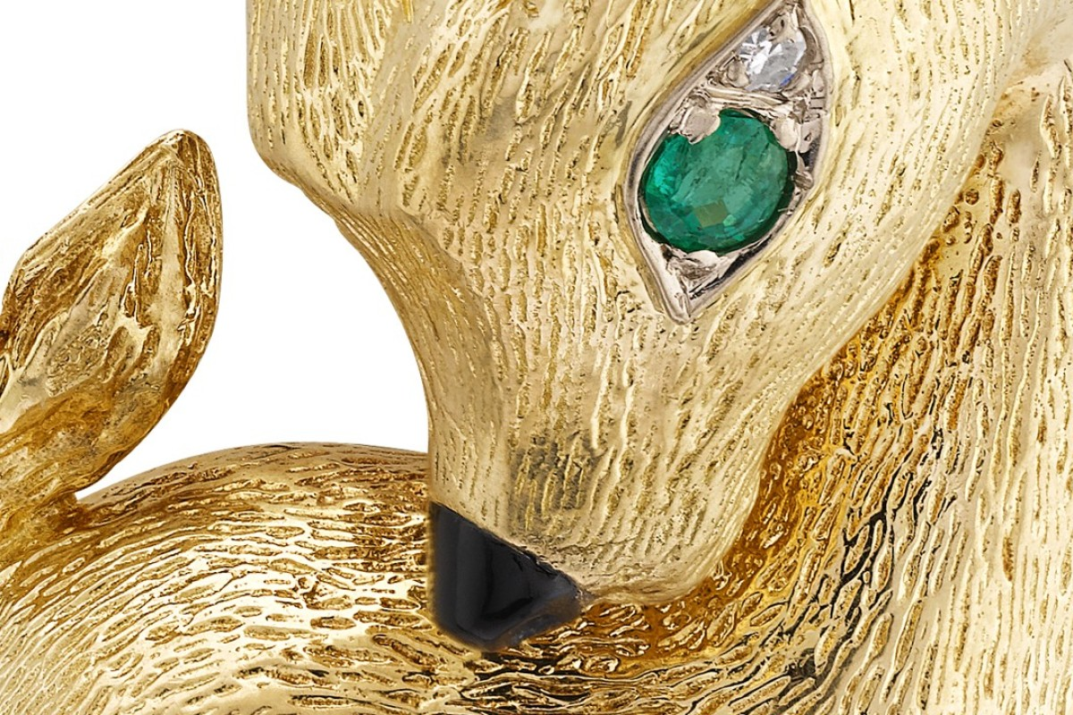 b23099a9e Van Cleef & Arpels made the Capricorn clip of yellow and white gold,  emerald,