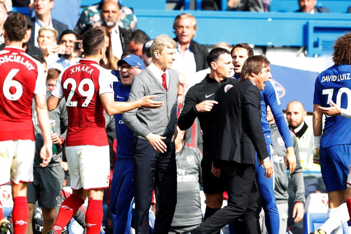 b0a1b8d1f Chelsea manager Antonio Conte reacts while Arsenal manager Arsene Wenger  looks on after David Luiz was