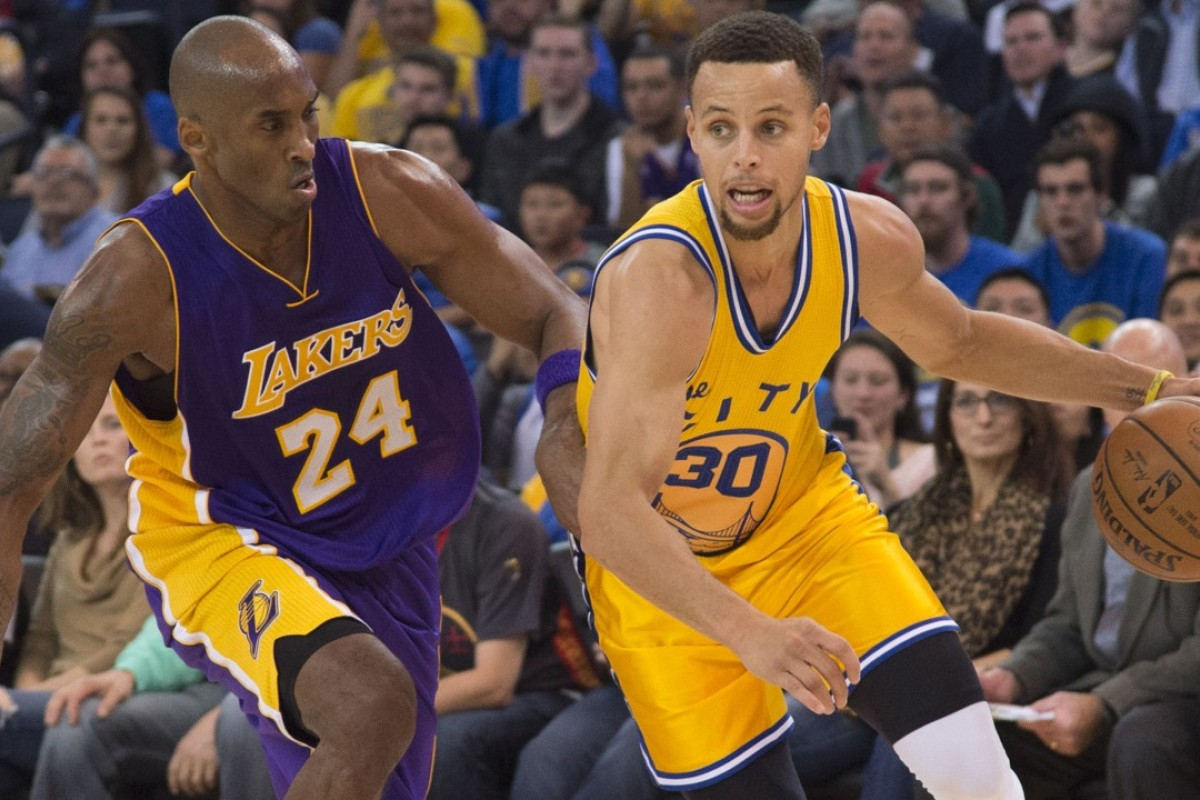 2c6e72a3 Golden State Warriors guard Stephen Curry dribbles past Los Angeles Lakers  forward Kobe Bryant, but