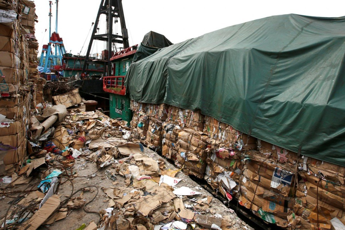 Tonnes of waste paper to be shipped to mainland China pile up at a dock in Hong Kong. Photo: Reuters