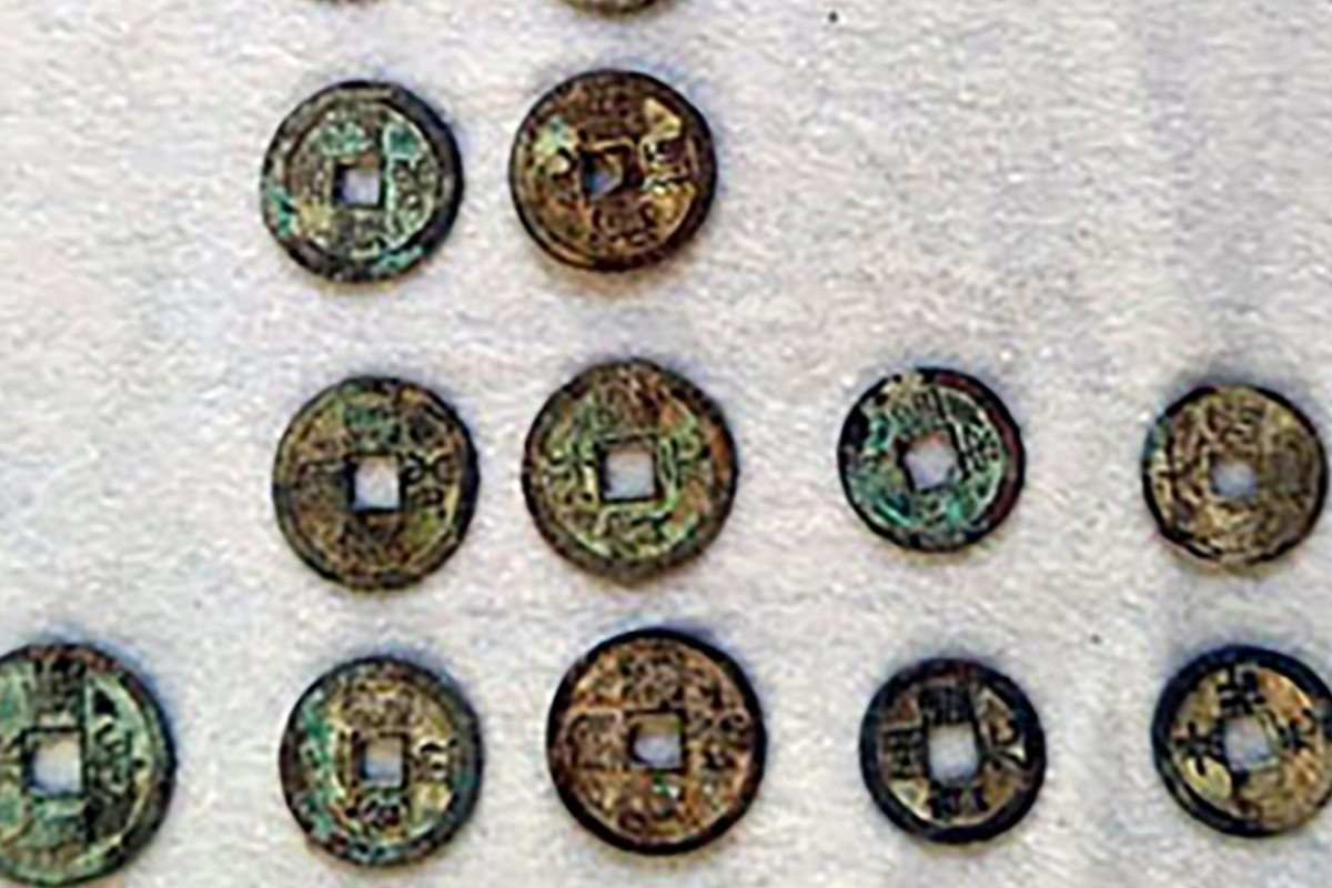 Mystery over tonnes of ancient coins found buried in Chinese