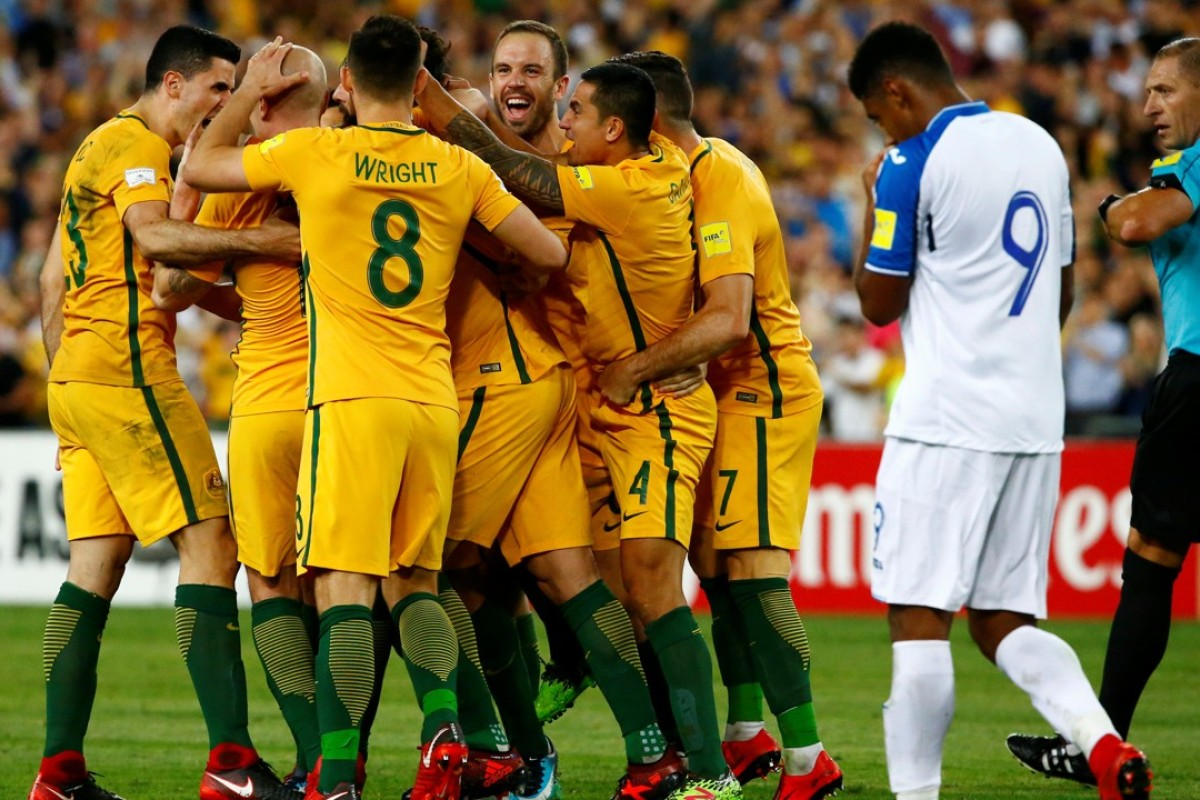 980c963dabe Australia s Mile Jedinak is mobbed after he scores his team s first goal as  Honduras  Anthony