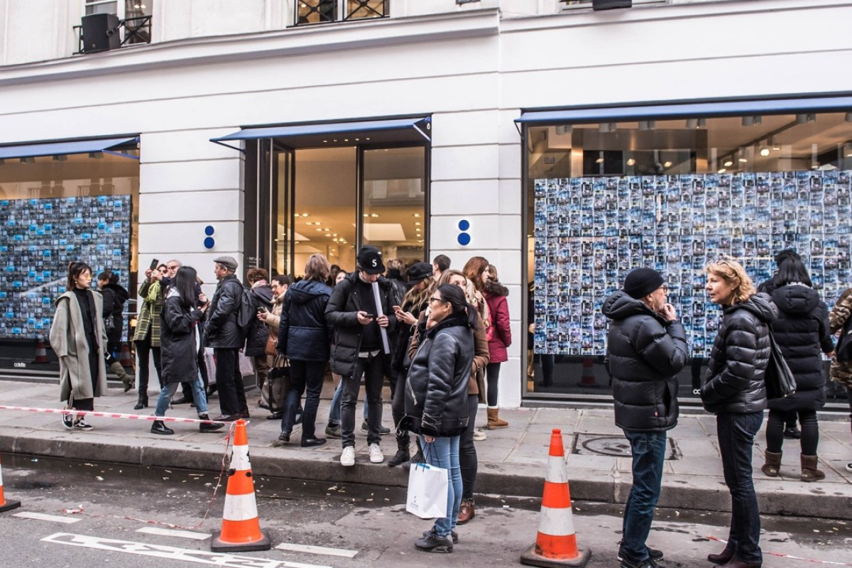f1ec1adcd1 People wait outside the Colette Concept Store in Paris on Tuesday. After 20  years