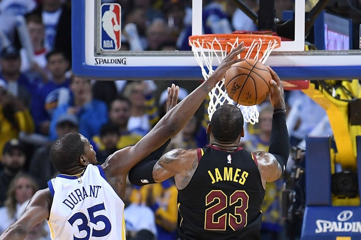 2d1024fe542b Kevin Durant of the Golden State Warriors blocks LeBron James  shot late in  the fourth