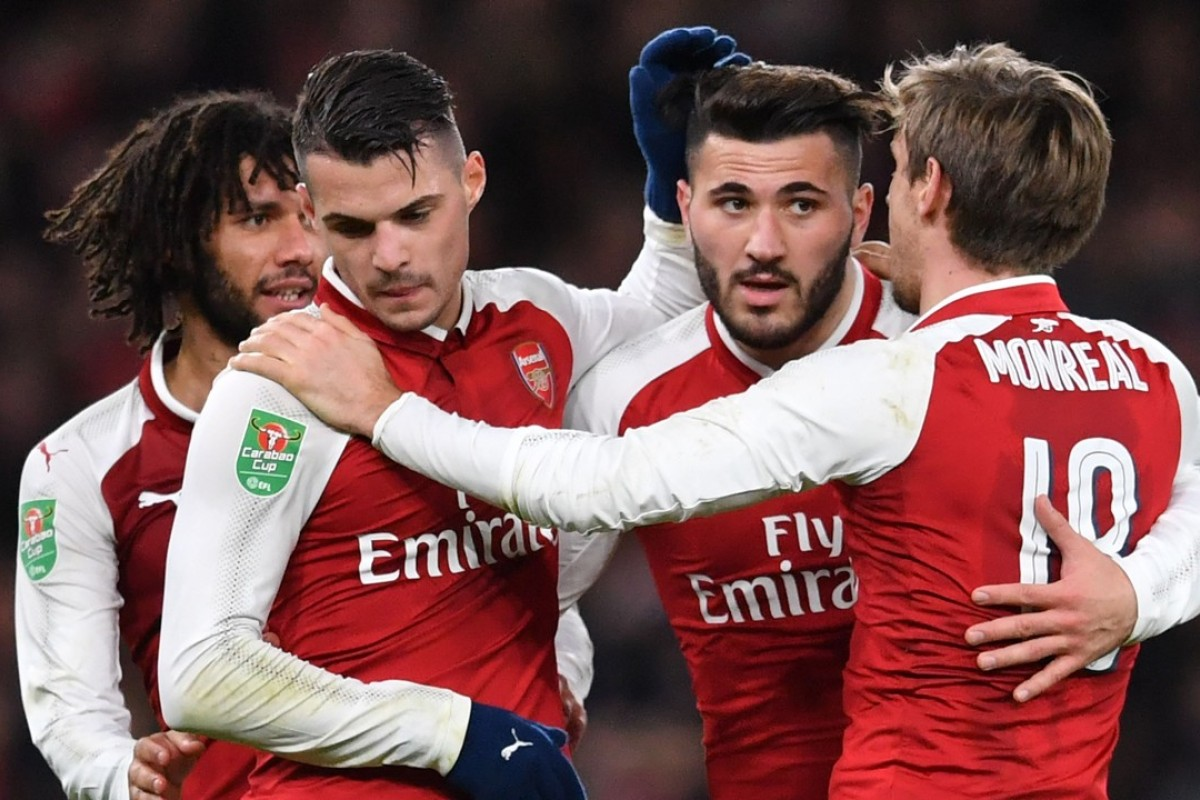 18d0dbafe Arsenal players celebrate their win over Chelsea at the final whistle.  Photo  AFP