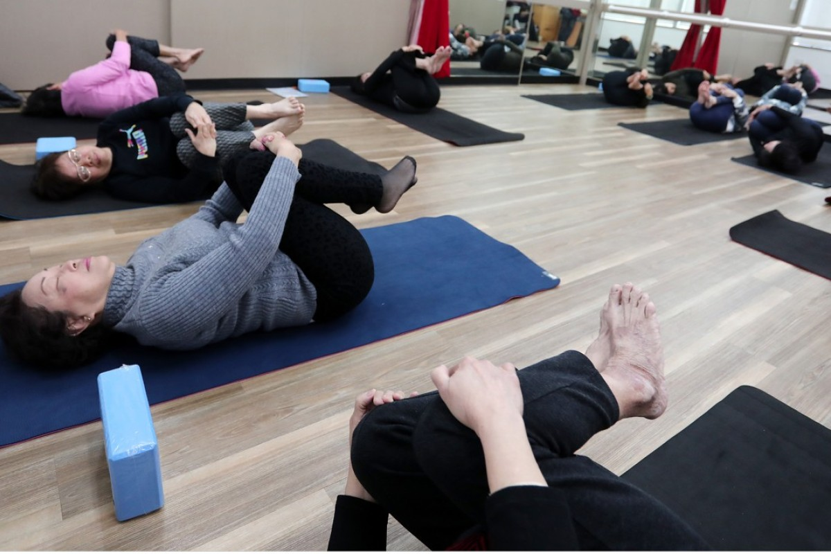 7a0c612b0aad Hong Kong seniors discover yoga: now they have even more energy and ...