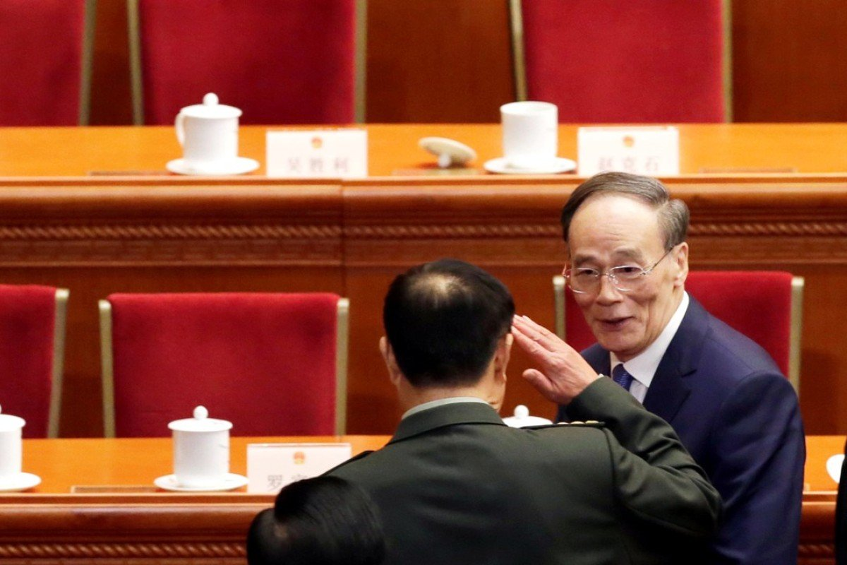 Premier Li Keqiang has the spotlight but Wang Qishan is the centre of attention