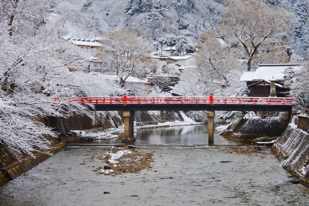 The brilliant red Nakabashi Bridge in Takayama, in Japan's mountainous Gifu Prefecture, stands out against its winter backdrop.