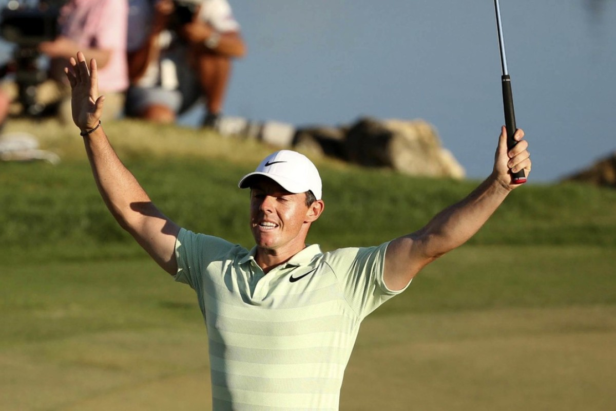 0274e60eb4cd2 Rory McIlroy celebrates after sinking a birdie putt on the 18th green to  win the Arnold