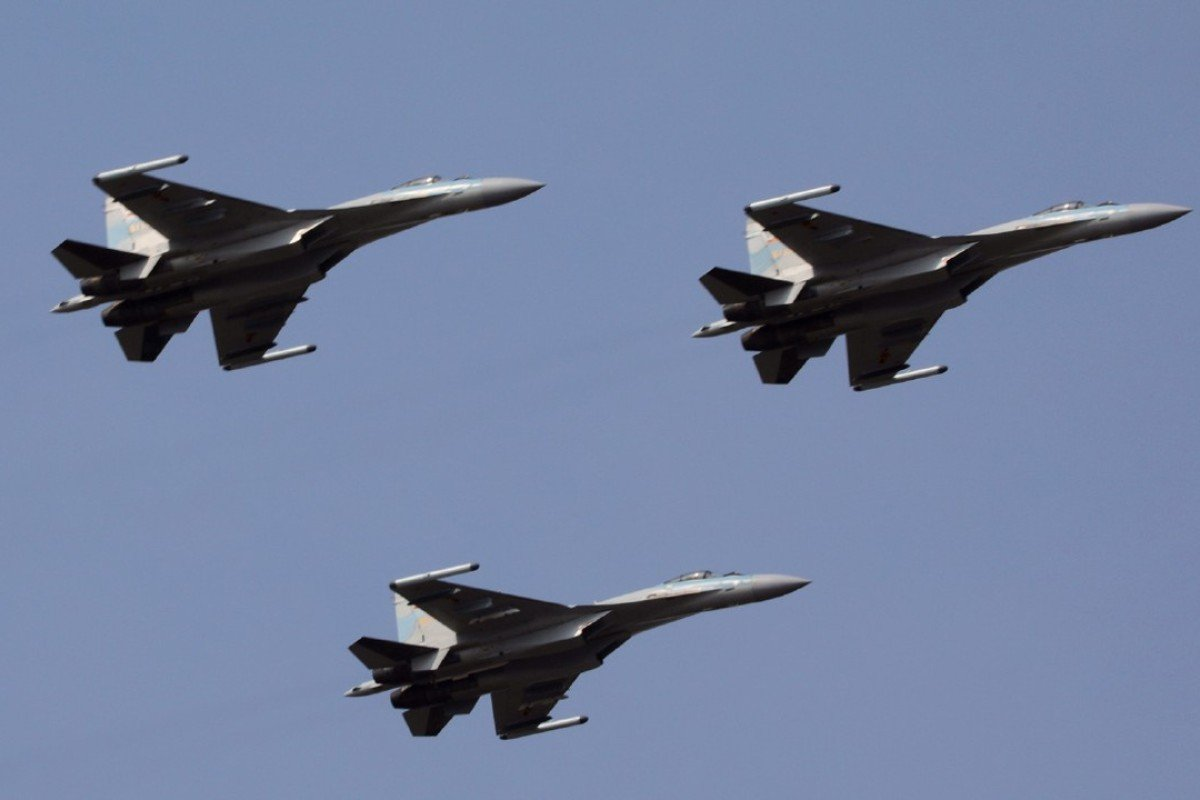 Chinese air force holds drills over South China Sea, Western Pacific