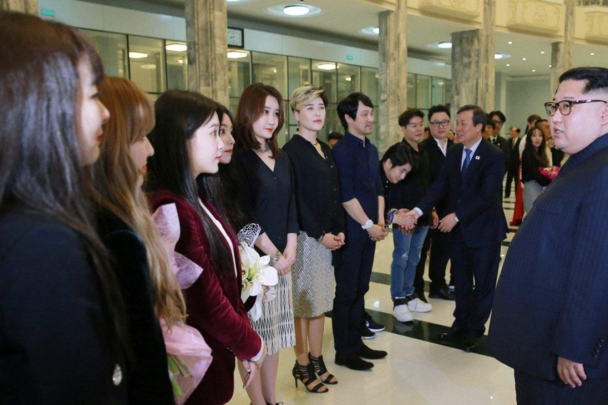 f8b27f58e5b794 INorth Korean leader Kim Jong-un talks to members of the South Korean  artistic group