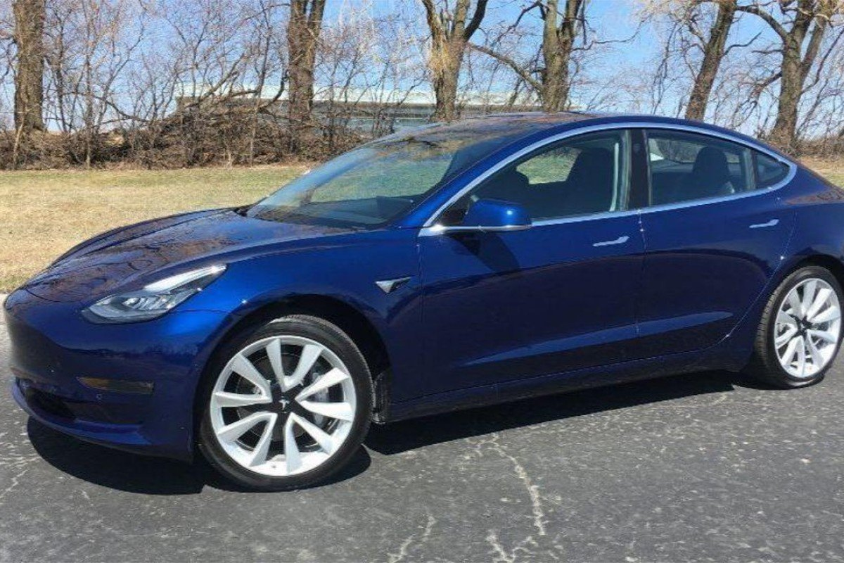 The Tesla Model 3 In Deep Blue Metallic Paint With 19 Inch