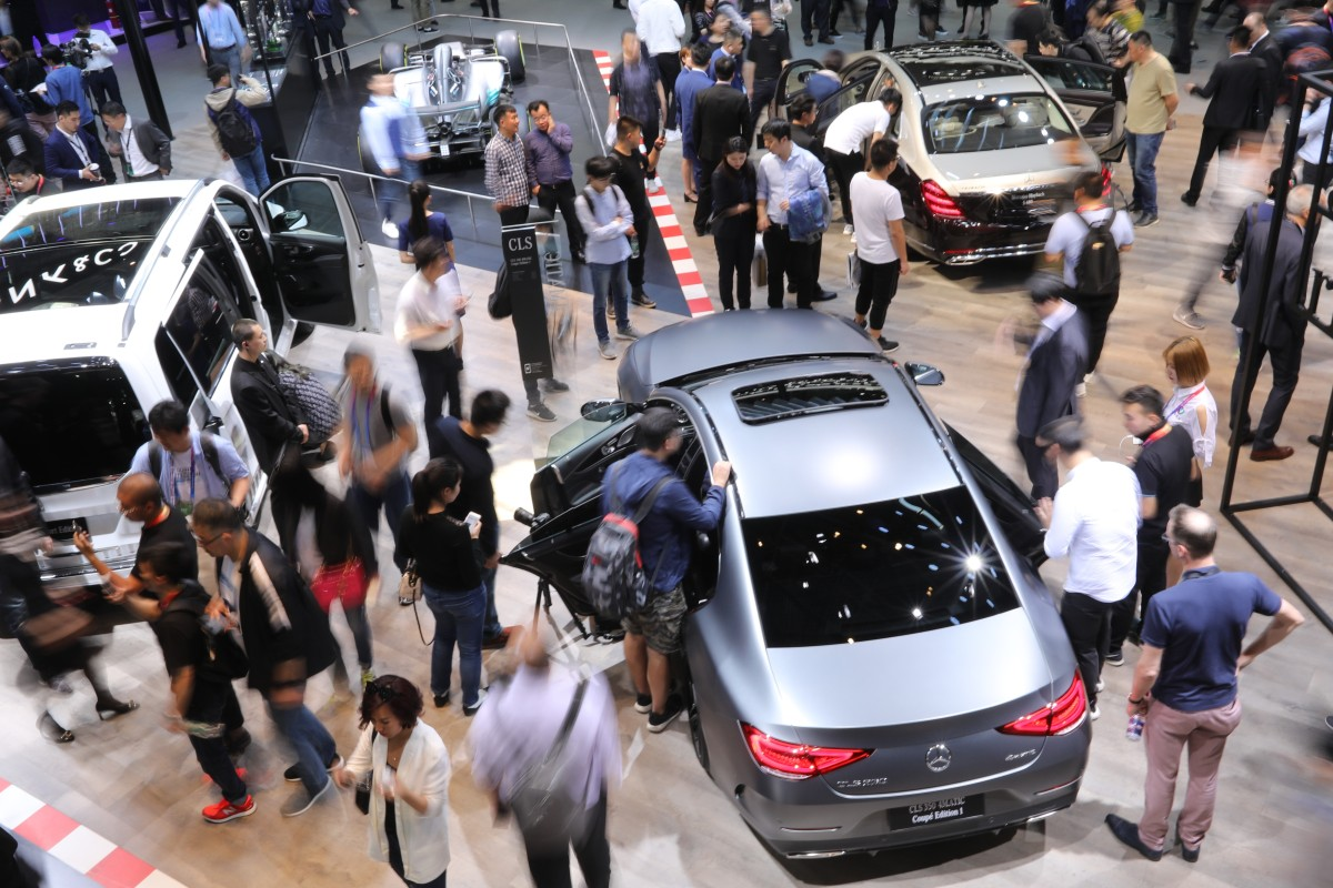 Visitors At The Auto China Which Is Being Held In Beijing Until May 4