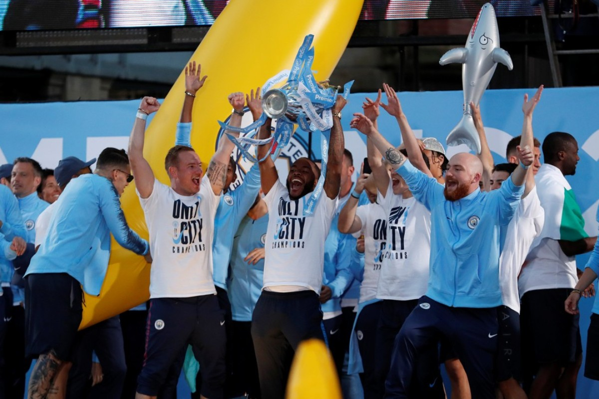 21a815c31de4 Manchester City players celebrate with the Premier League title on their  winner's parade. Photo: