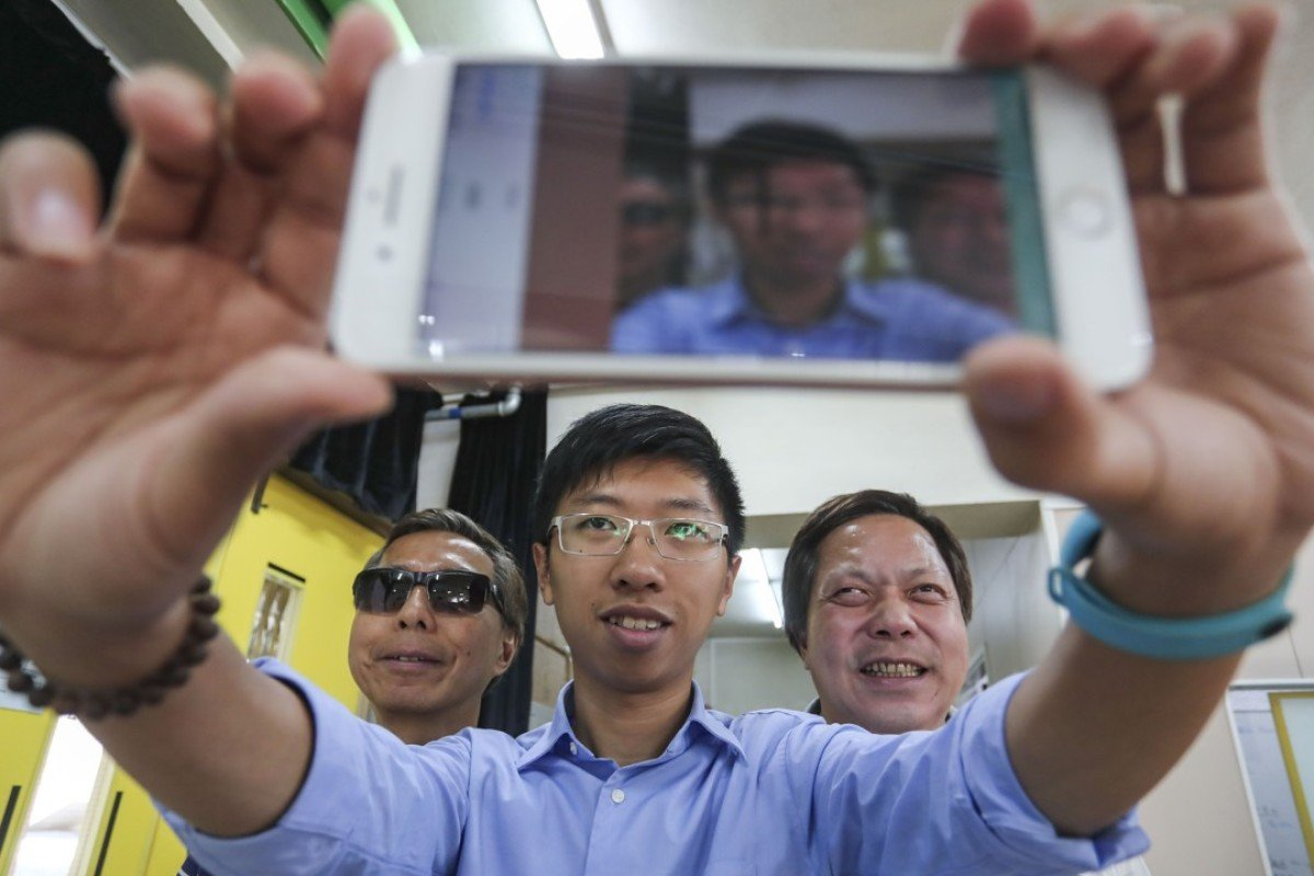 Lo Hoi (left), Michael Fung and Tang Kwong-po, chairman of the Hong Kong Federation of the Blind, which helped test the app. Photo: Jonathan Wong