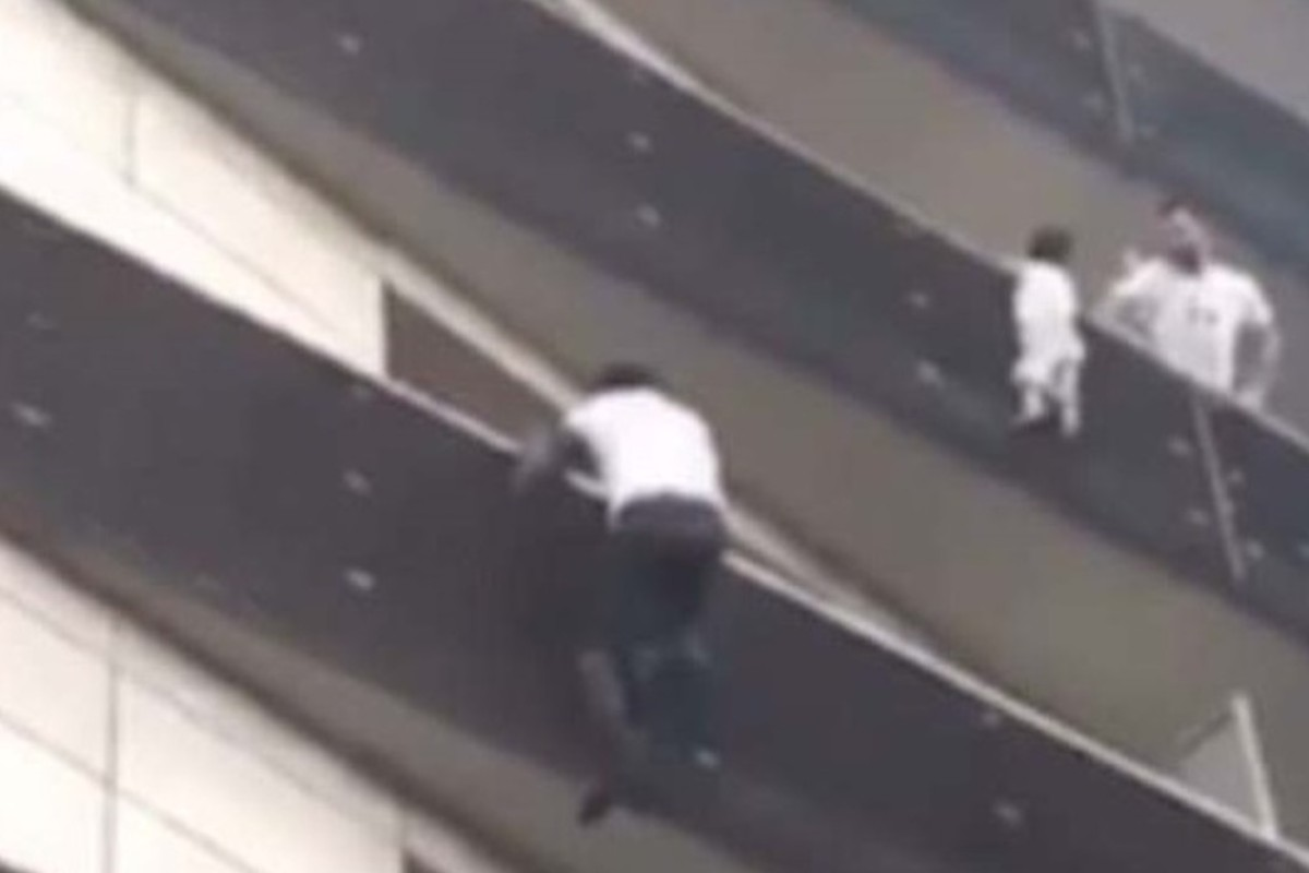 Watch: real-life Spider-Man scrambles up four storeys to