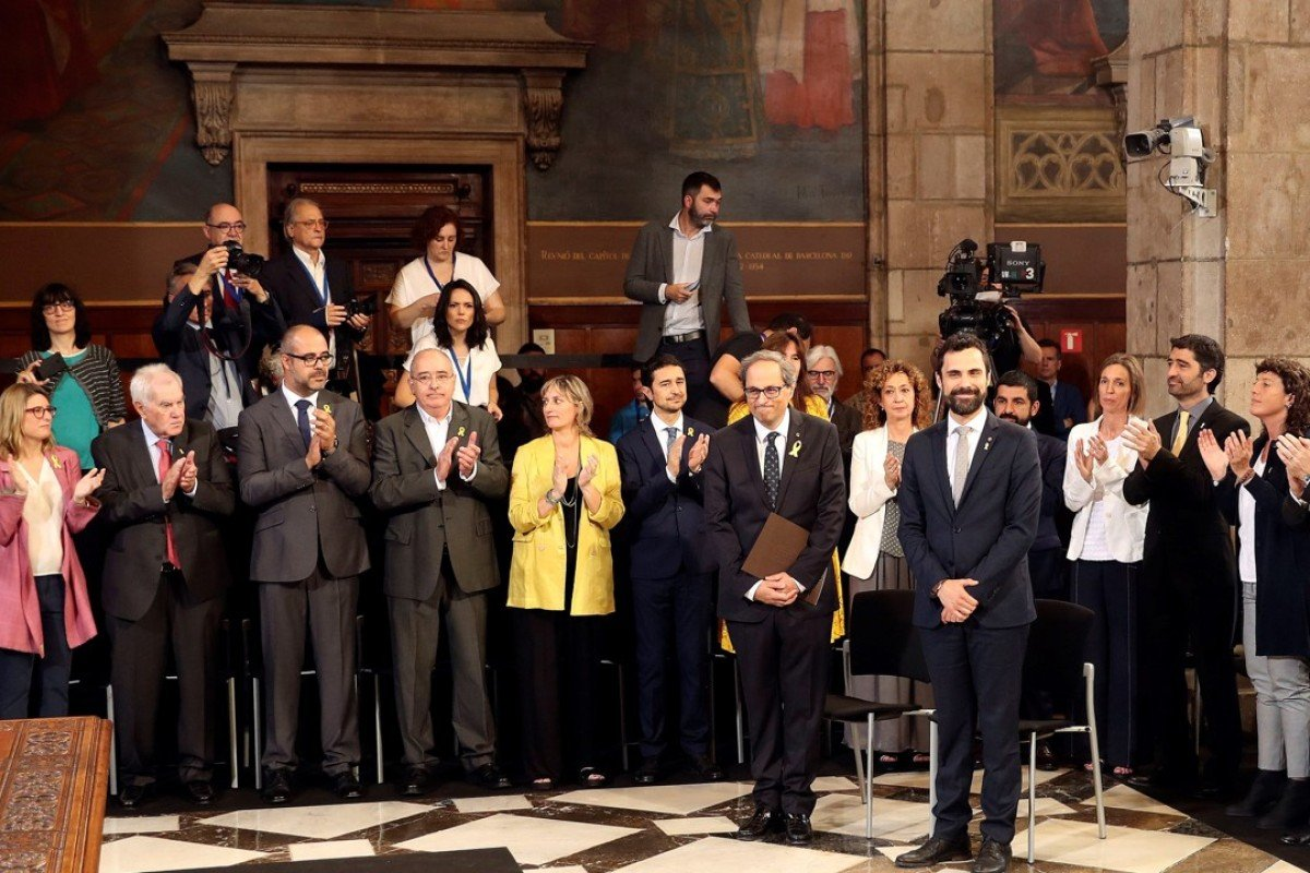 Catalonia's new chief vows to continue secession push as Spain's new PM Pedro Sanchez is sworn in