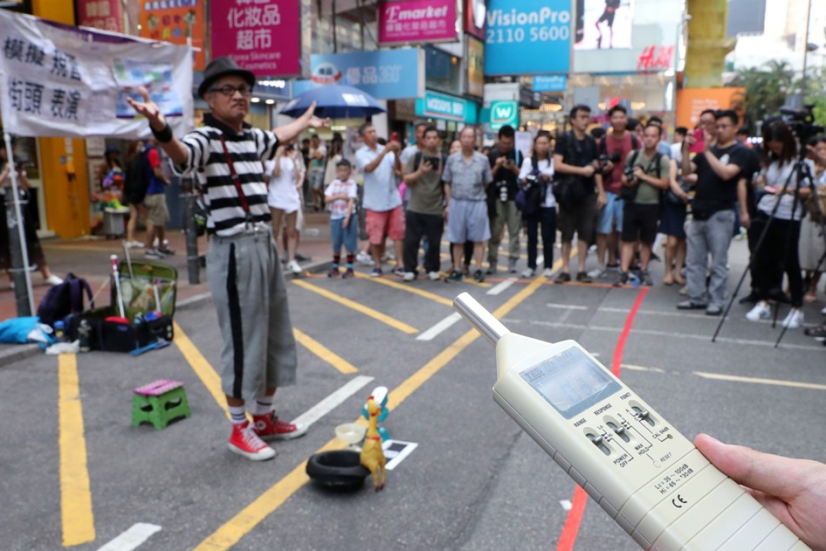 Mong Kok buskers lower decibel levels as mock regulations on