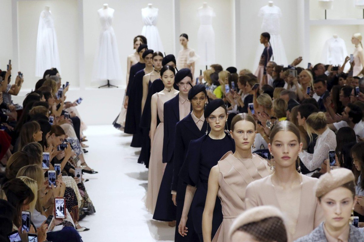 a0ebfa8e90a321 Models present simple yet elegant clothing from Dior's autumn/winter haute  couture collection fashion show