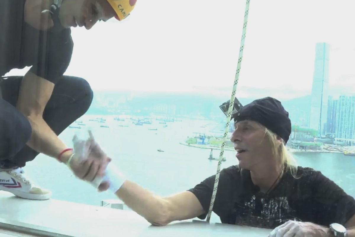French Spider-Man' Alain Robert spotted climbing Hong Kong's