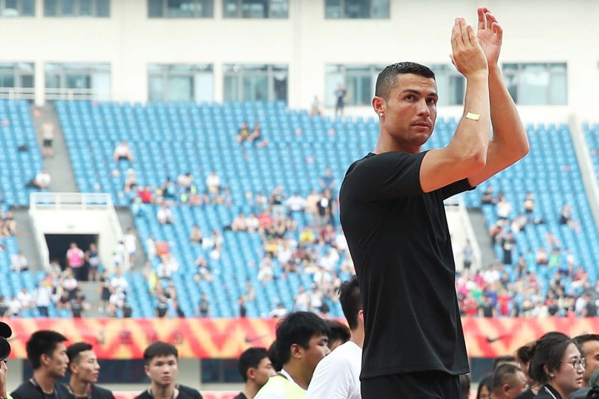 b901836c19b5ed Portuguese football player Cristiano Ronaldo greets fans as he attends a  promotional event in Beijing.