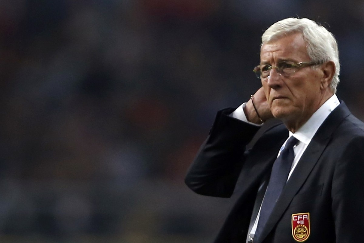 f2e2a8d8032 China coach Marcello Lippi watches the match against Wales at the 2018  China Cup in March