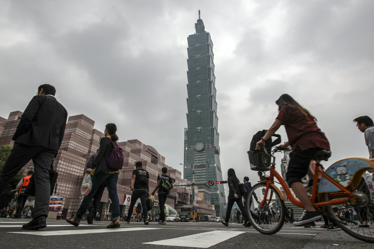 Taiwan growth hit by low technology exports and US-China trade war