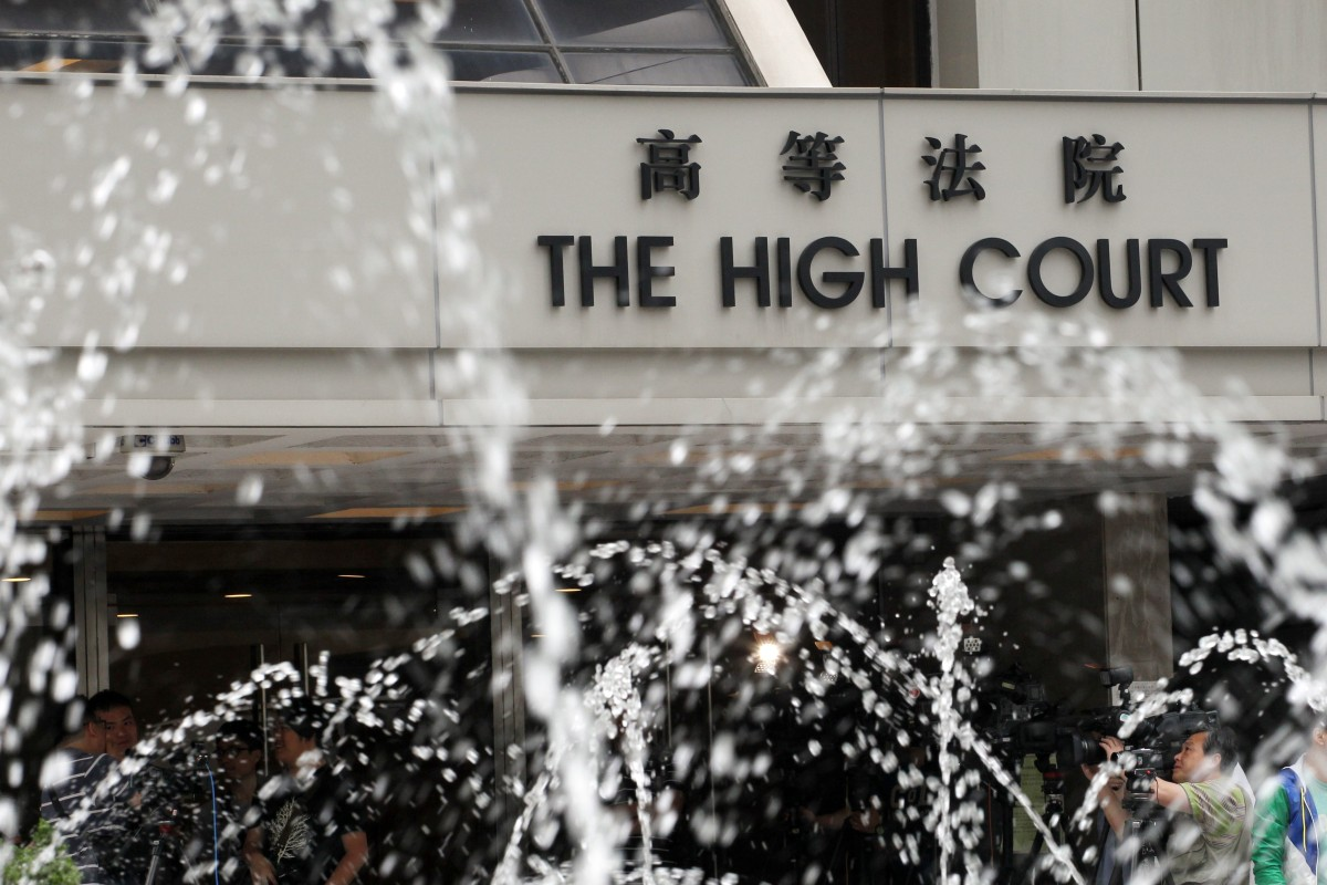 Hong Kong man cries and bangs head on table as jury finds him guilty