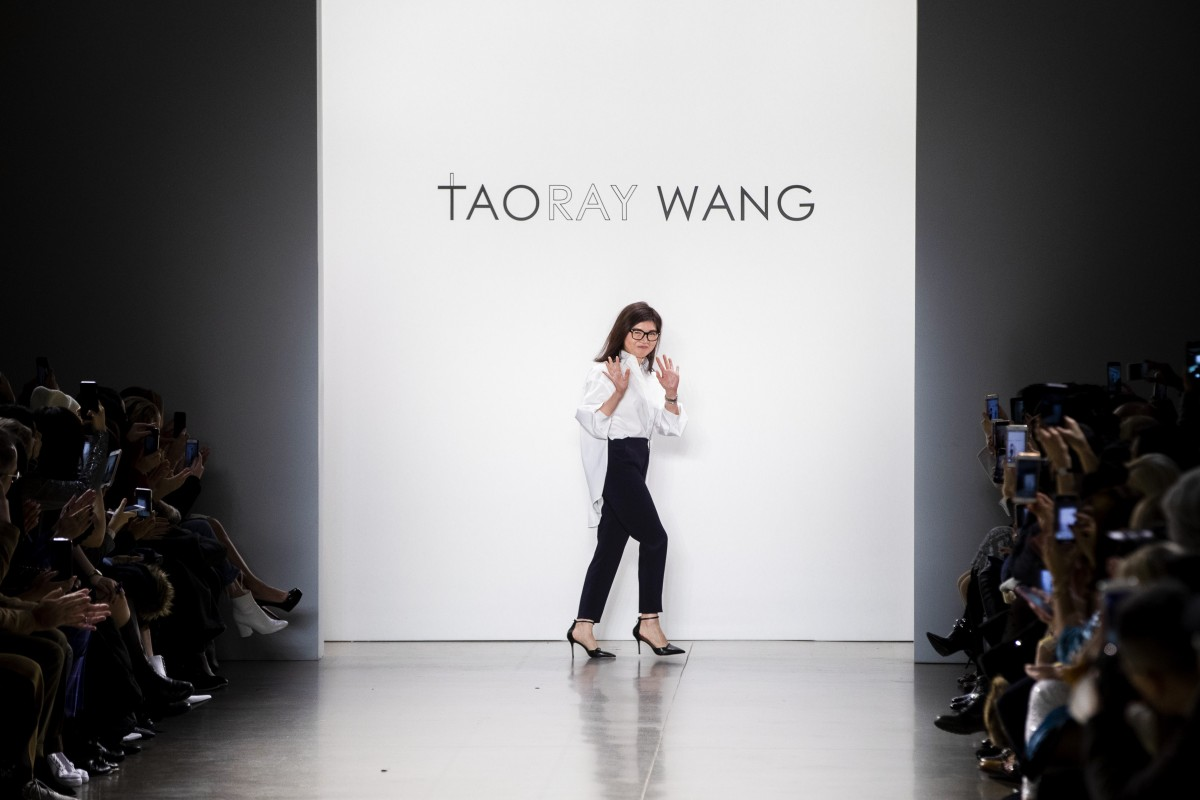 0300b18aec5 Chinese fashion designer Wang Tao greets the audience after presenting her  Taoray Wang autumn-winter