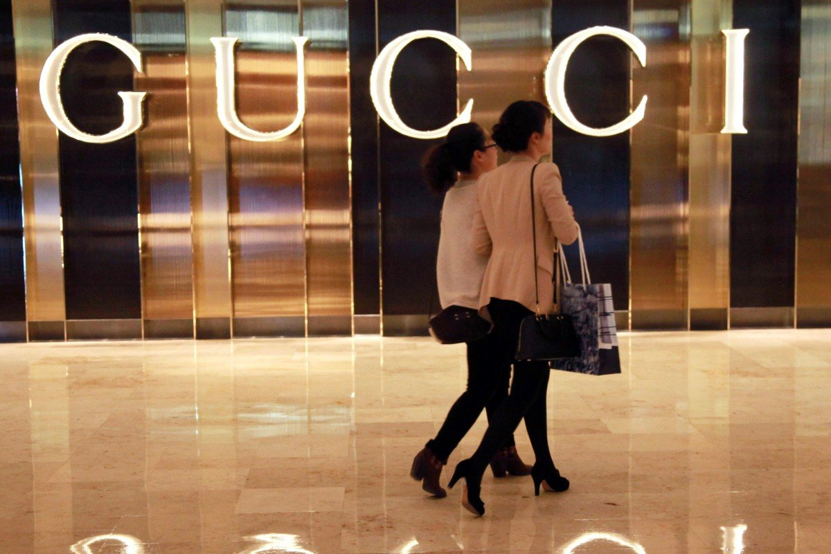 74be796c1 Shoppers walking past a Gucci shop in Nanjing, east China's Jiangsu  province. Photo: