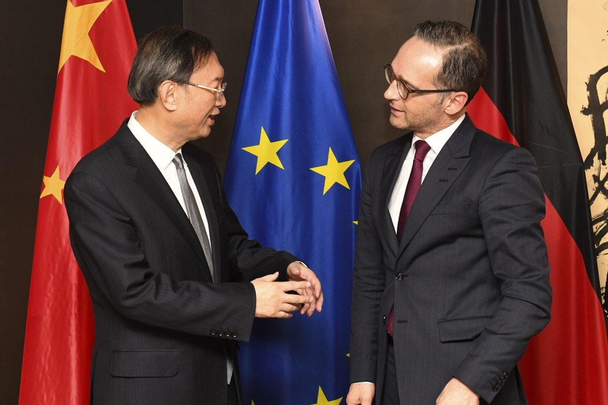 Chinea's top envoy Yang Jiechi chats to German Foreign Minister Heiko Maas at the Munich Security Conference. Photo: AP