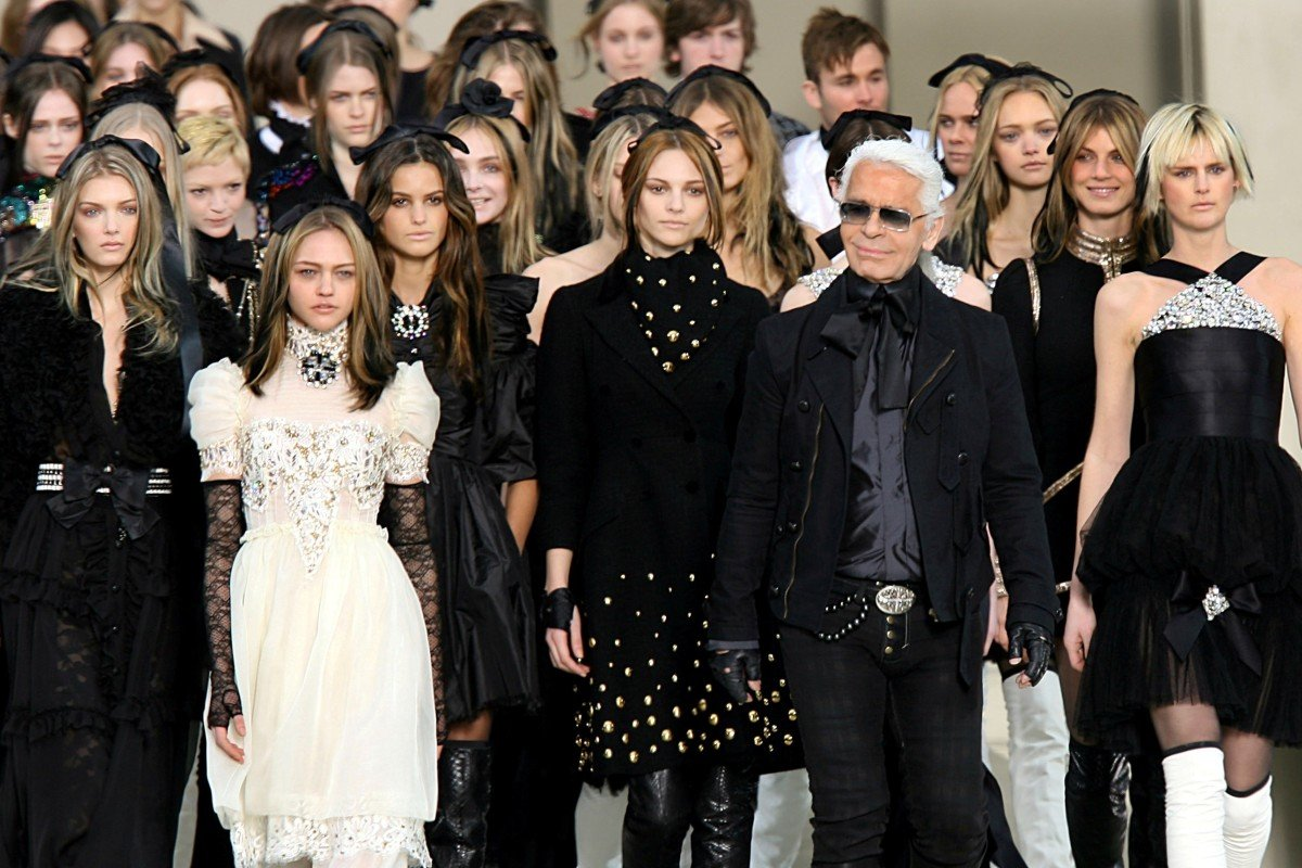 2aa27fa1720 German designer Karl Lagerfeld (front row, second from right) leads models  on the
