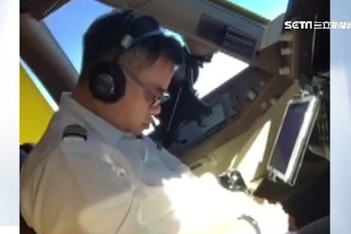 China Airlines pilot punished after he's filmed sleeping in cockpit