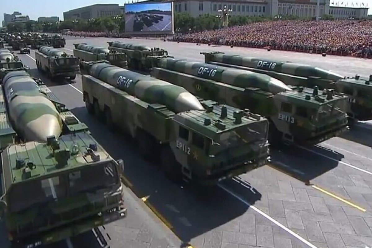 Military vehicles carrying DF-16 ballistic missiles take part in China's National Day parade. Taiwan says Beijing has such missiles trained on the self-ruled island. Photo: Handout