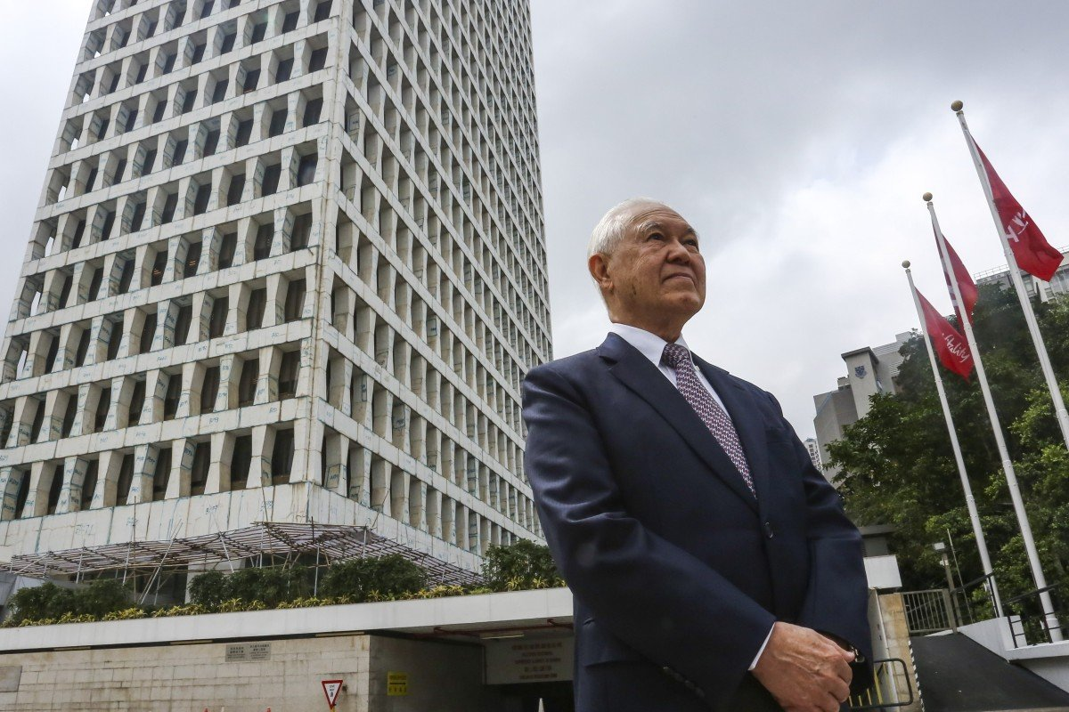 AIA Group's Edmund Tse Sze-wing stands outside the AIA building in Wan Chai.