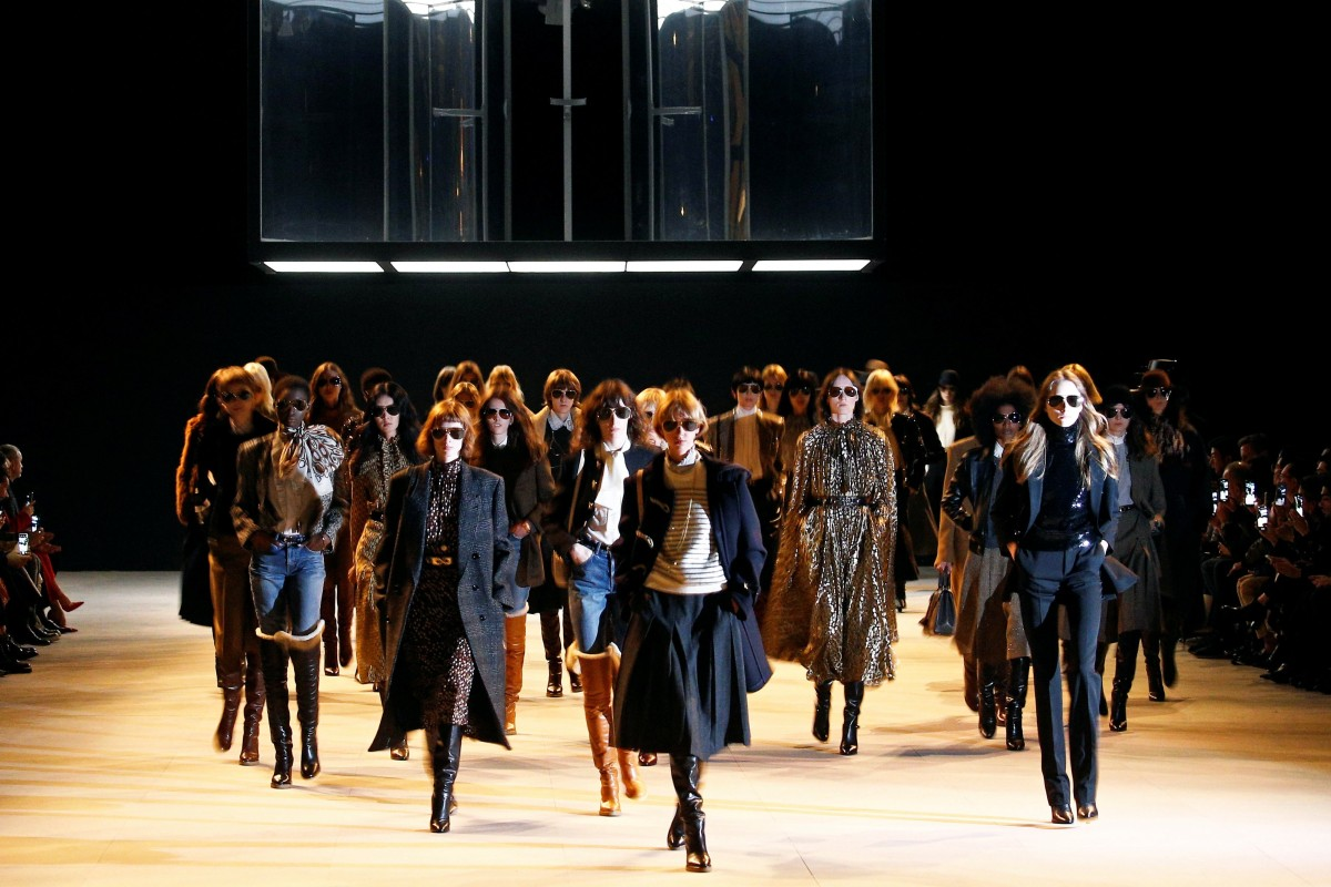 8aea3a8a0756d Catwalk models present creations by designer Hedi Slimane during his Celine  fall/winter 2019/
