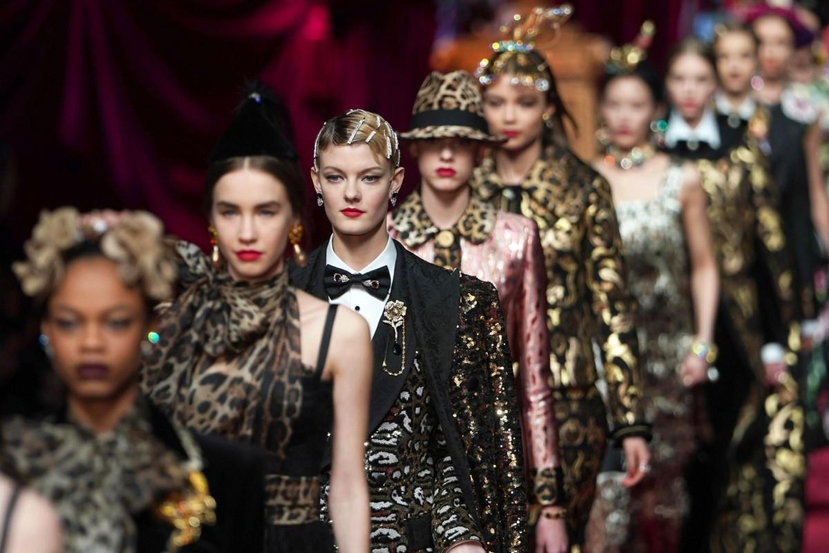 35cbd591da Models present creations from Dolce   Gabbana s autumn-winter collection at  Milan Fashion Week.
