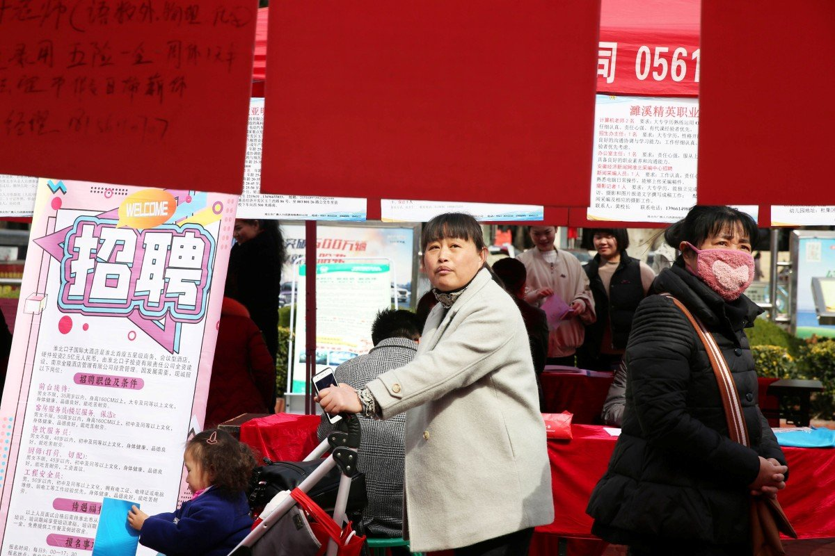 Job seekers look at the job advertisements at a job fair for women on the International Women's Day in Huaibei, Anhui province, on Friday. Photo: Reuters