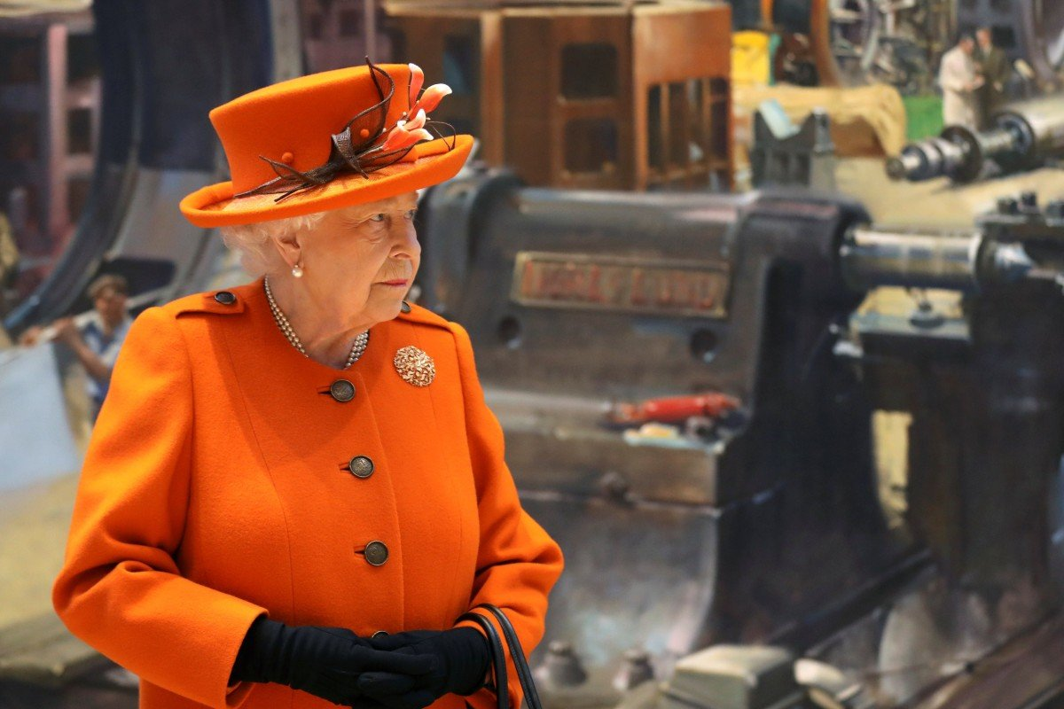 Britain's Queen Elizabeth uses Apple iPad to make her first