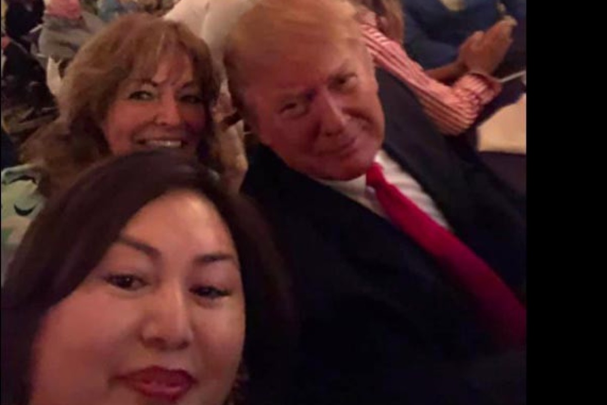 Cindy Yang (front) snaps a selfie with US President Donald Trump at a Super