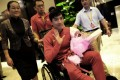 Liu Xiang arrives yesterday after surgery in London.Photo: AFP